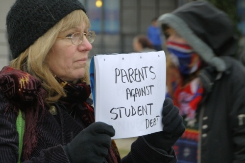 Parents against student debt - sign held on London anti-fees protest on 9 December 2010