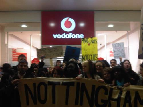 Nottingham students against fees and cuts inside Vodaphone during EMA protest on 11th Jan 2011