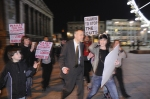Jon Collins harangued during evening protest